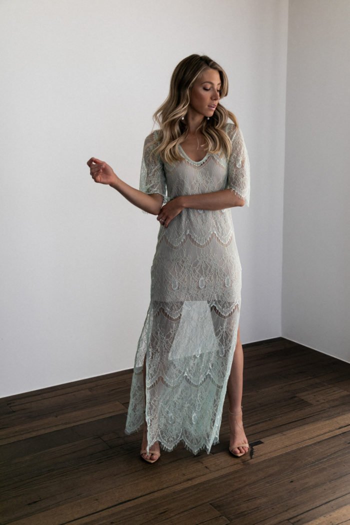 Bridesmaid wearing Grace Loves Lace Lace Maxi Dress in Peridot with nude heels
