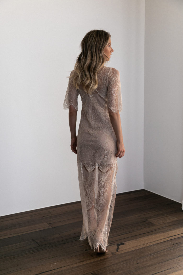 Back shot of bridesmaid wearing Grace Loves Lace Lace Maxi Dress in Champagne