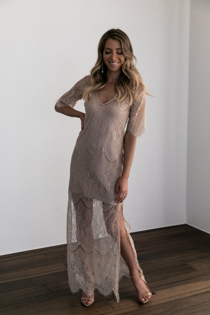 Bridesmaid wearing Grace Loves Lace Lace Maxi Dress in Champagne with nude heels