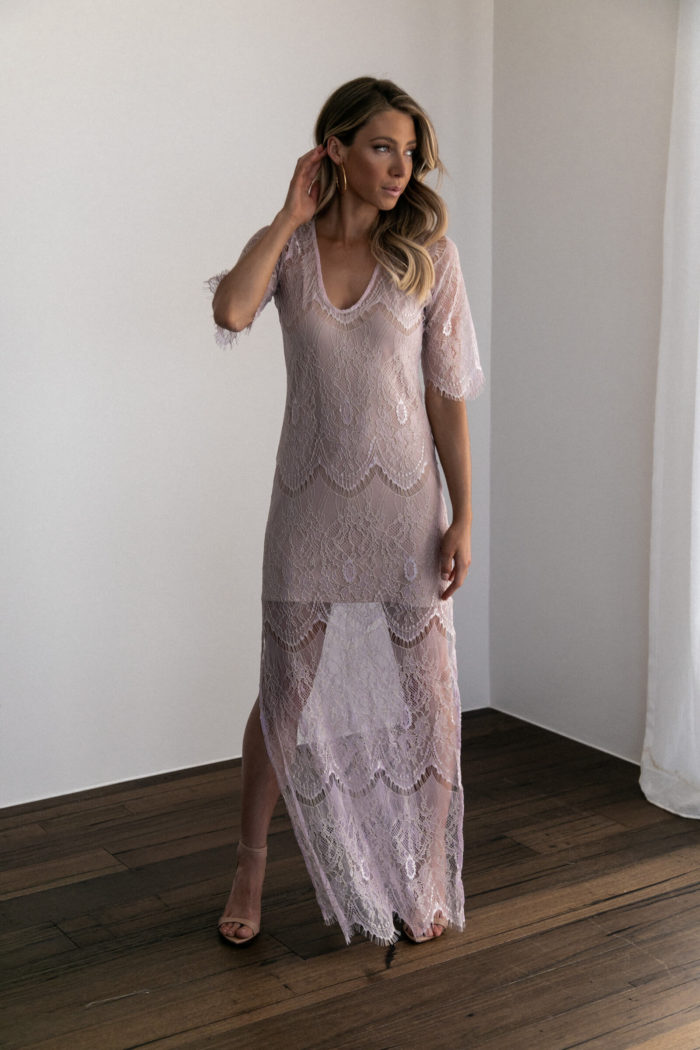 Bridesmaid wearing Grace Loves Lace Lace Maxi Dress in Amethyst with hand on hair