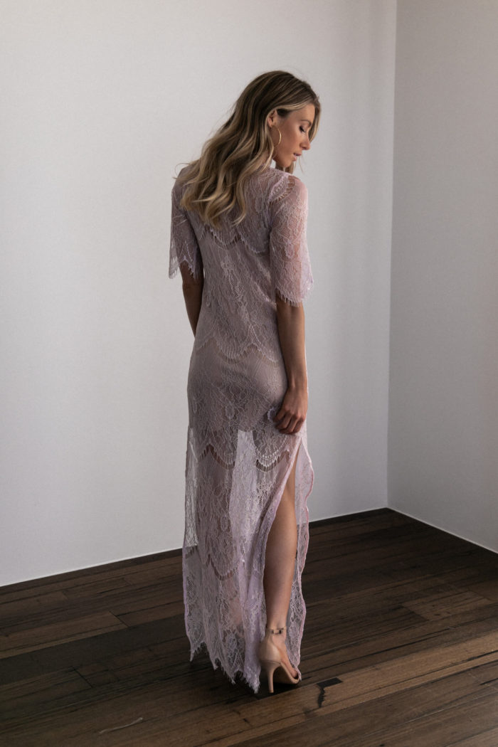 Back shot of bridesmaid wearing Grace Loves Lace Lace Maxi Dress in Amethyst