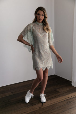 Bridesmaid wearing Grace Loves Lace High Neck Shift Dress in Peridot with white sneakers
