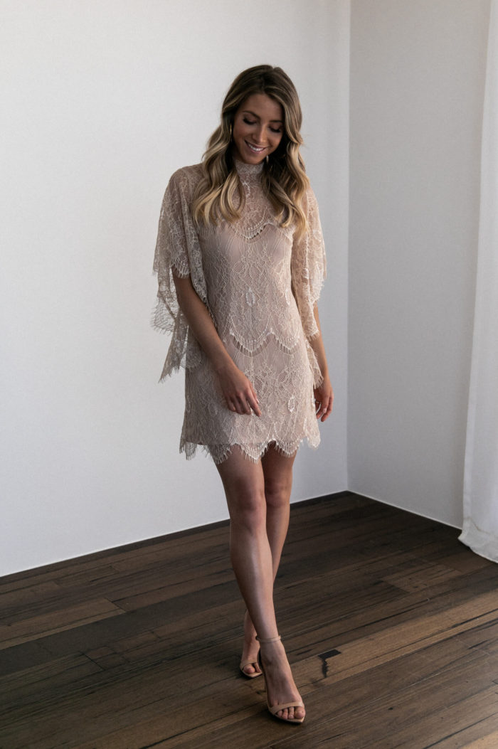 Bridesmaid wearing Grace Loves Lace High Neck Shift Dress in Champagne with nude heels