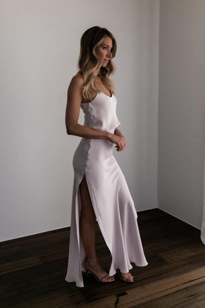Side shot of bridesmaid wearing Grace Loves Lace Belle Silk Split Skirt in Oyster