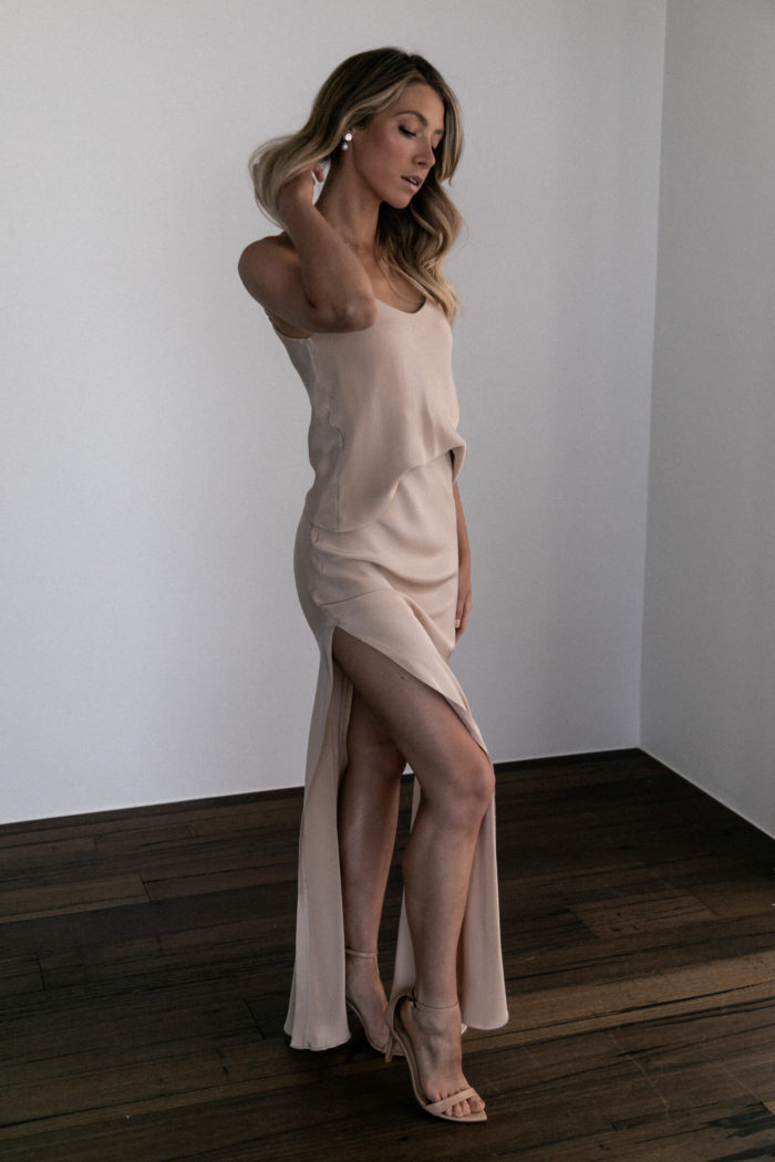 Bridesmaid wearing Grace Loves Lace Belle Long Silk Cami in Sandstone with hand on hair