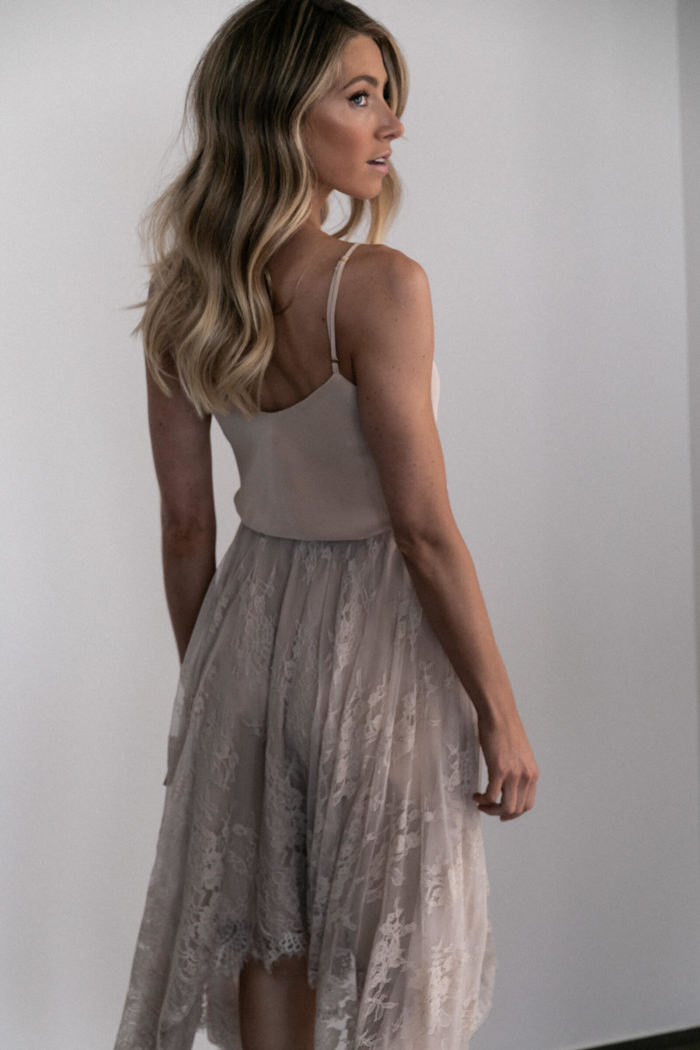 Back shot of bridesmaid wearing Grace Loves Lace Belle Long Silk Cami in Sandstone
