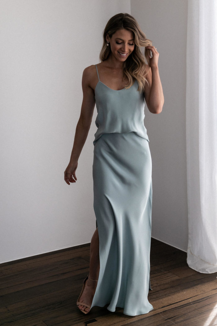 Bridesmaid wearing Grace Loves Lace Belle Long Silk Cami in Seaglass with pearl earrings
