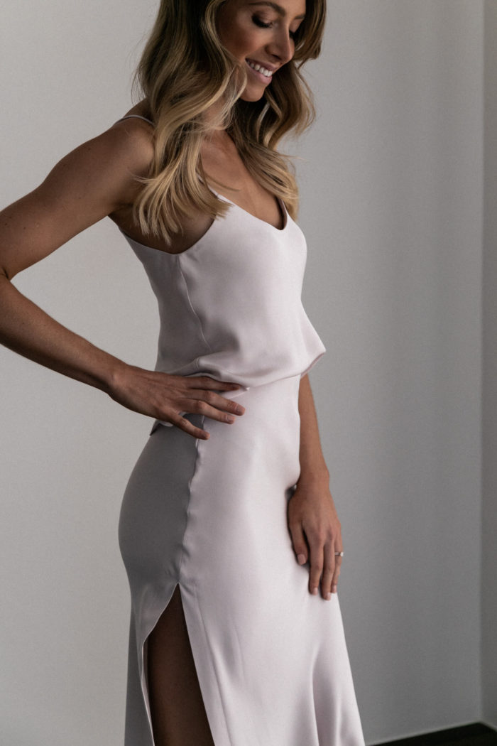 Bridesmaid wearing Grace Loves Lace Belle Long Silk Cami in Oyster with hand on hip