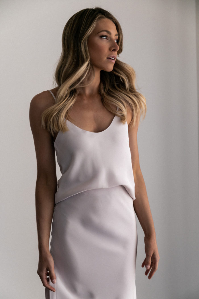 Bridesmaid wearing Grace Loves Lace Belle Long Silk Cami in Oyster looking to the side