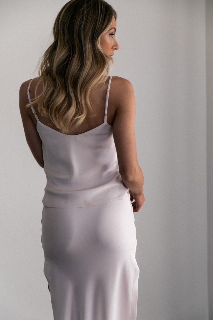Back shot of bridesmaid wearing Grace Loves Lace Belle Long Silk Cami in Oyster