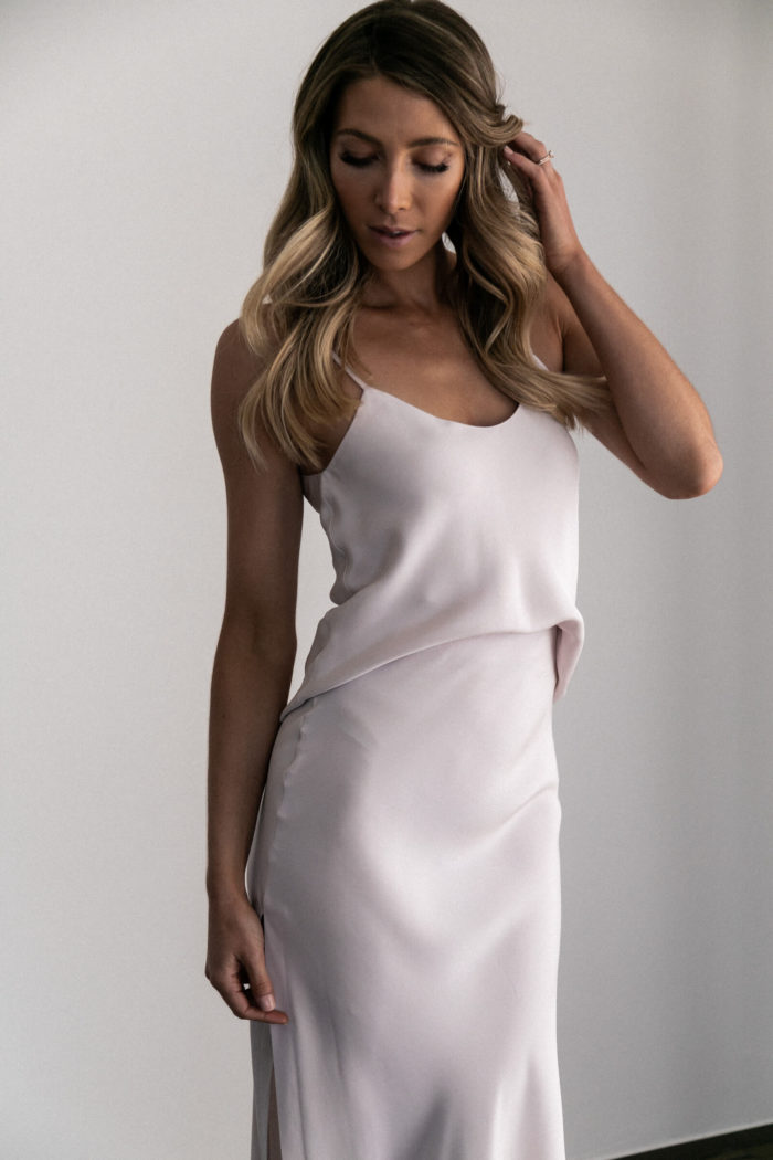 Bridesmaid wearing Grace Loves Lace Belle Long Silk Cami in Oyster with hand on hair