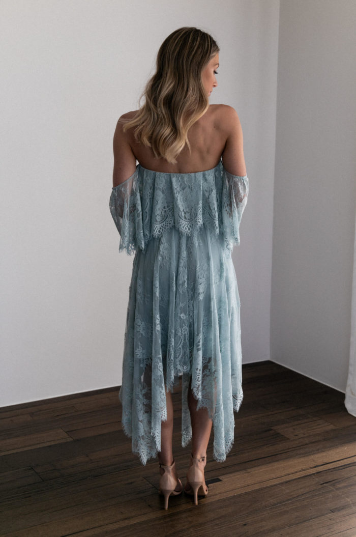 Back shot of bridesmaid wearing Grace Loves Lace Belle Lace Swing Skirt in Seaglass