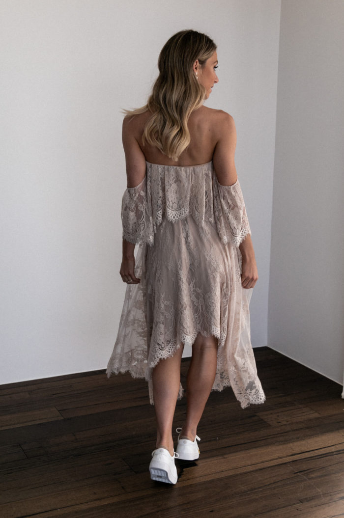 Back shot of bridesmaid wearing Grace Loves Lace Belle Lace Swing Skirt in Sandstone