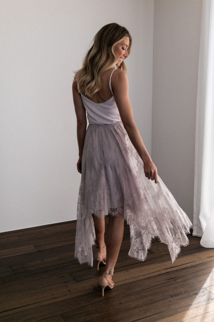 Back shot of bridesmaid wearing Grace Loves Lace Belle Lace Swing Skirt in Oyster