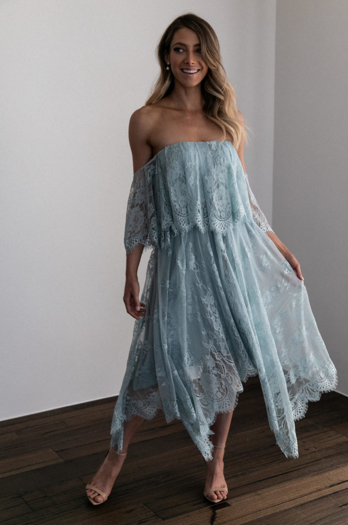 Bridesmaid wearing Grace Loves Lace Belle Lace Strapless Top in Seaglass with pearl earrings