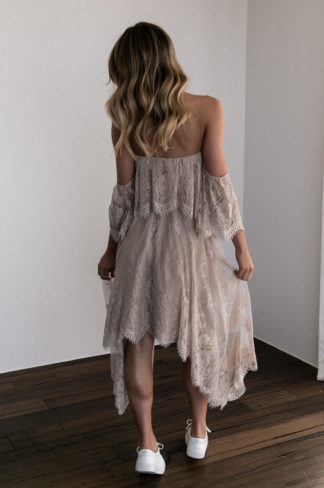 Back shot of bridesmaid wearing Grace Loves Lace Belle Lace Strapless Top in Sandstone