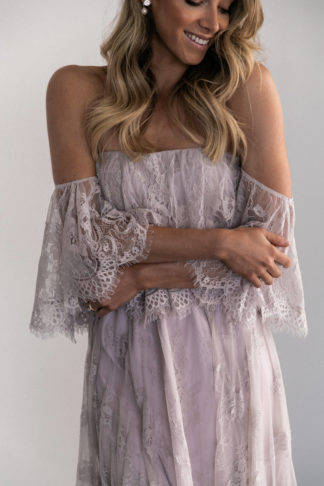 Bridesmaid wearing Grace Loves Lace Belle Lace Strapless Top in Oyster with arms crossed across torso