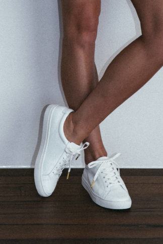Close-up of Grace Loves Lace Essential White Leather Sneakers
