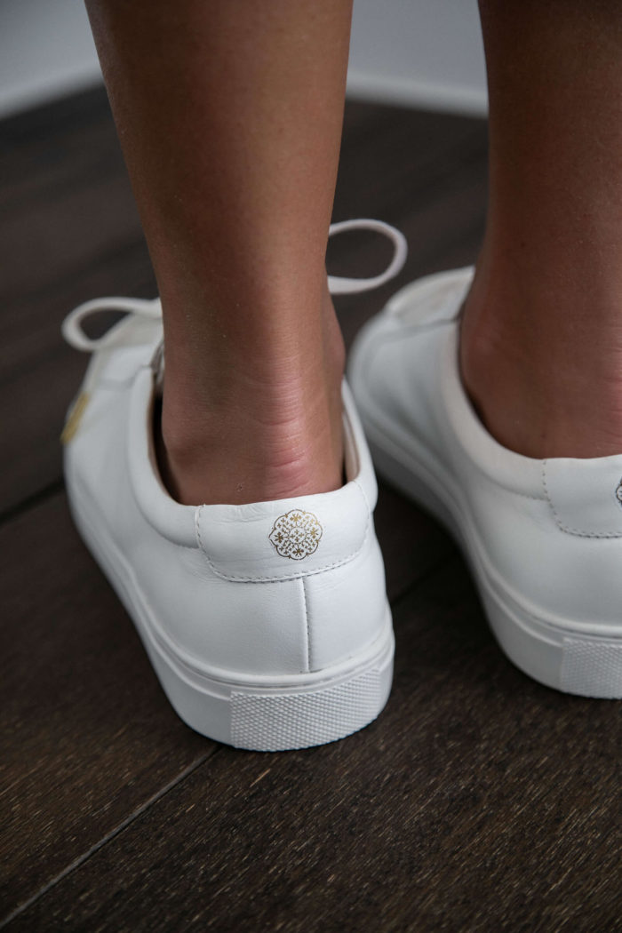 Close-up back shot of Grace Loves Lace Essential White Leather Sneakers
