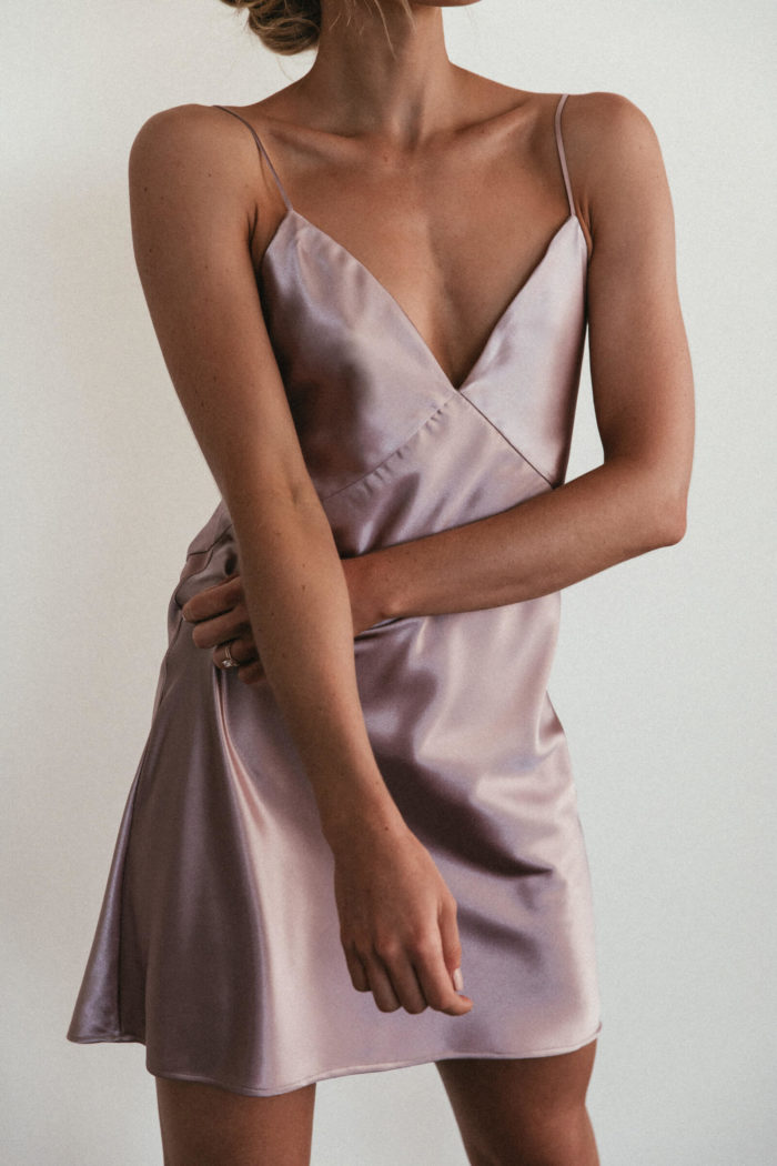 Bridesmaid wearing Grace Loves Lace Silky Satin Mini in Dusk with arm crossed