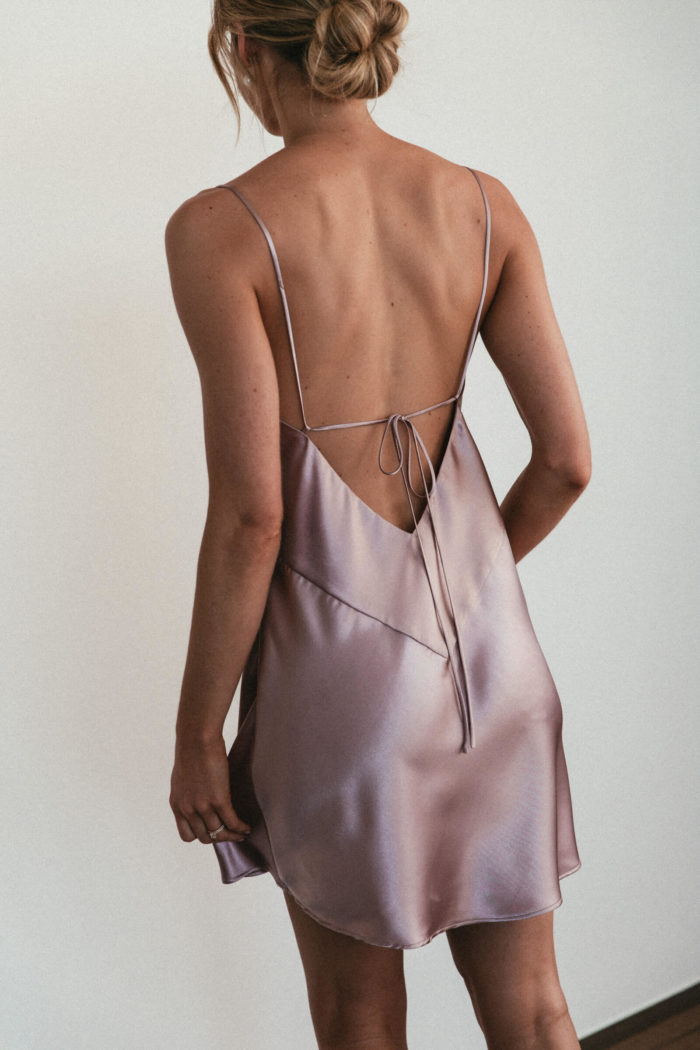 Back shot of bridesmaid wearing Grace Loves Lace Silky Satin Mini in Dusk