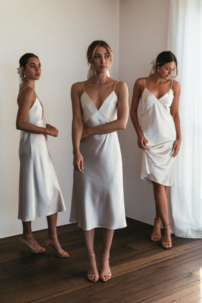 Bridesmaids wearing Grace Loves Lace Silky Satin Midi in Moonshine