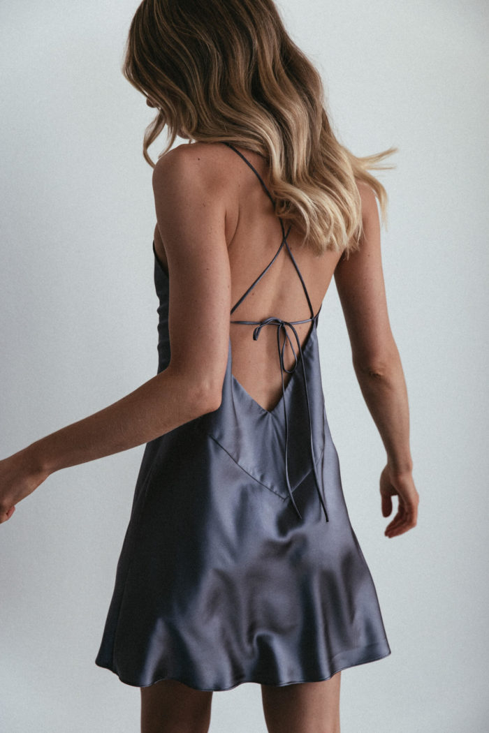 Back shot of bridesmaid wearing Grace Loves Lace Silky Satin Mini in Steele