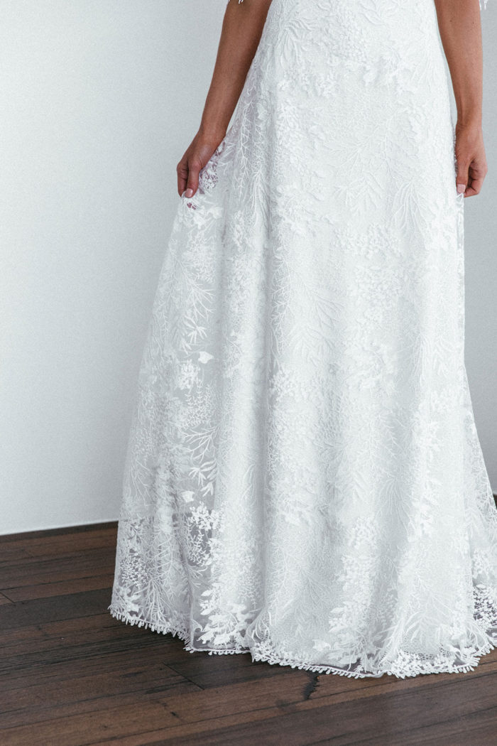 Close-up shot of Grace Loves Lace Sol Gown skirt