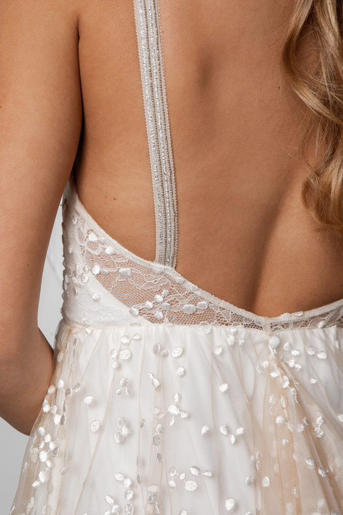 Close-up of bride wearing Grace Loves Lace Menha Gown