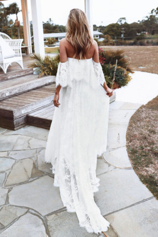 Back shot of blonde bride wearing Grace Loves Lace Florence Gown in Ivory