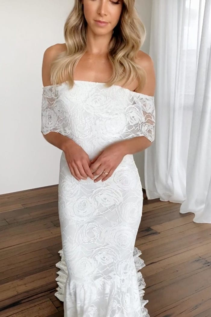 Blonde bride wearing Grace Loves Lace Peaches Gown with eyes closed