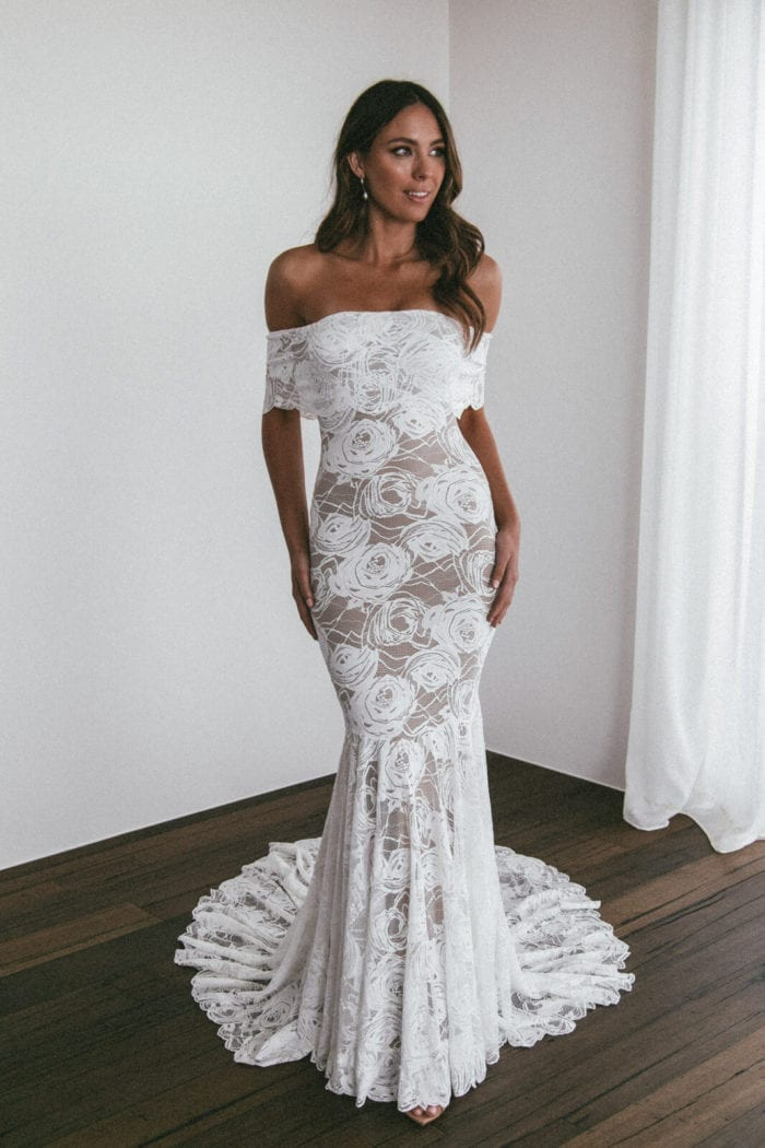 Brunette bride wearing Grace Loves Lace Peaches Gown looking to the side