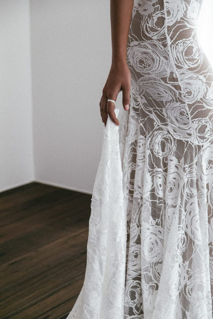 Close-up of bride wearing Grace Loves Lace Peaches Gown showing finger in finger loop