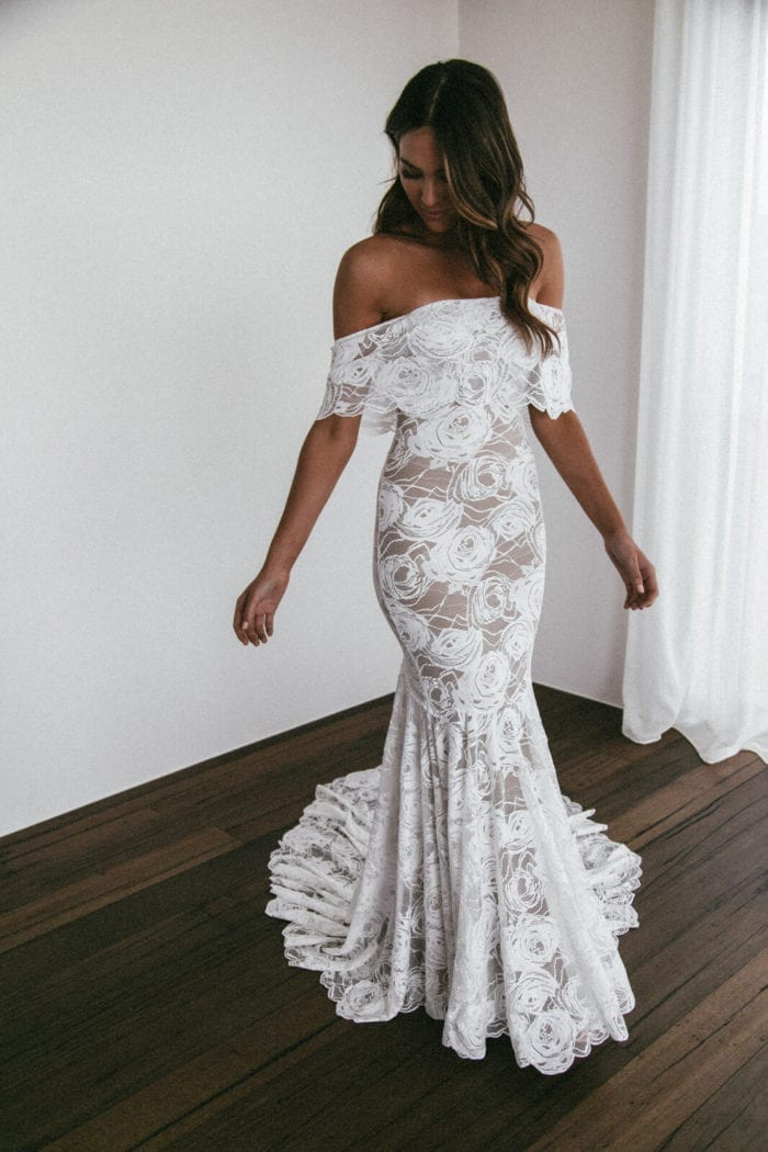 Brunette bride wearing Grace Loves Lace Peaches Gown looking at floor