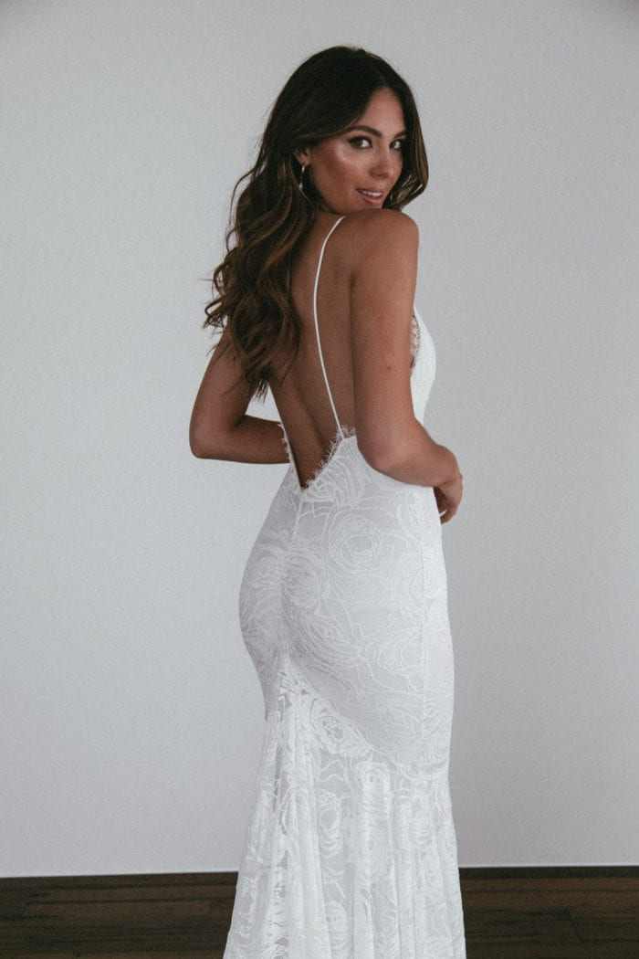 Back shot of bride wearing Grace Loves Lace Clo Gown looking over shoulder