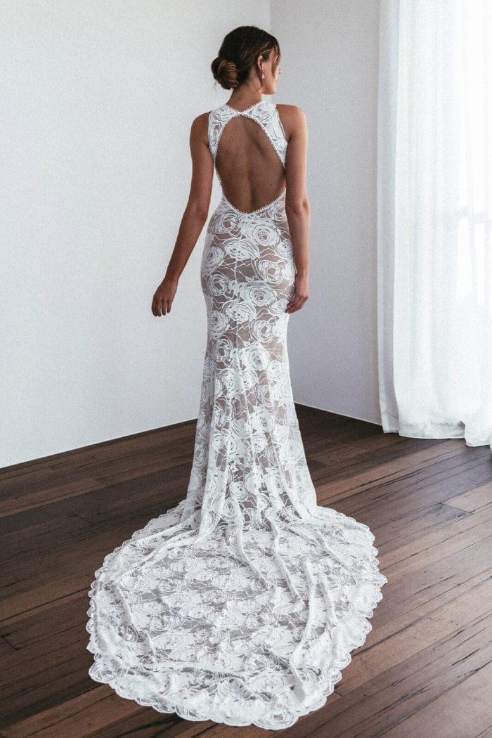 Back shot of bride wearing Grace Loves Lace Alexandra Rose Gown looking to the side
