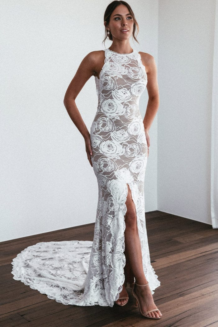 Bride wearing Grace Loves Lace Alexandra Rose Gown with hands on buttocks