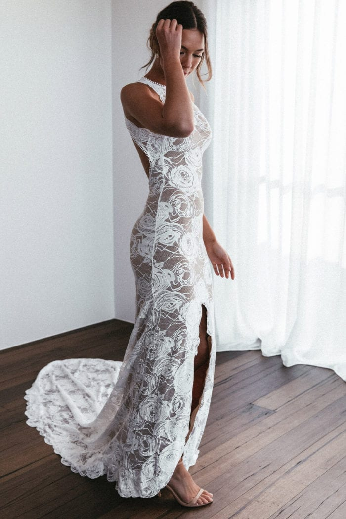 Bride wearing Grace Loves Lace Alexandra Rose Gown with hand on hair