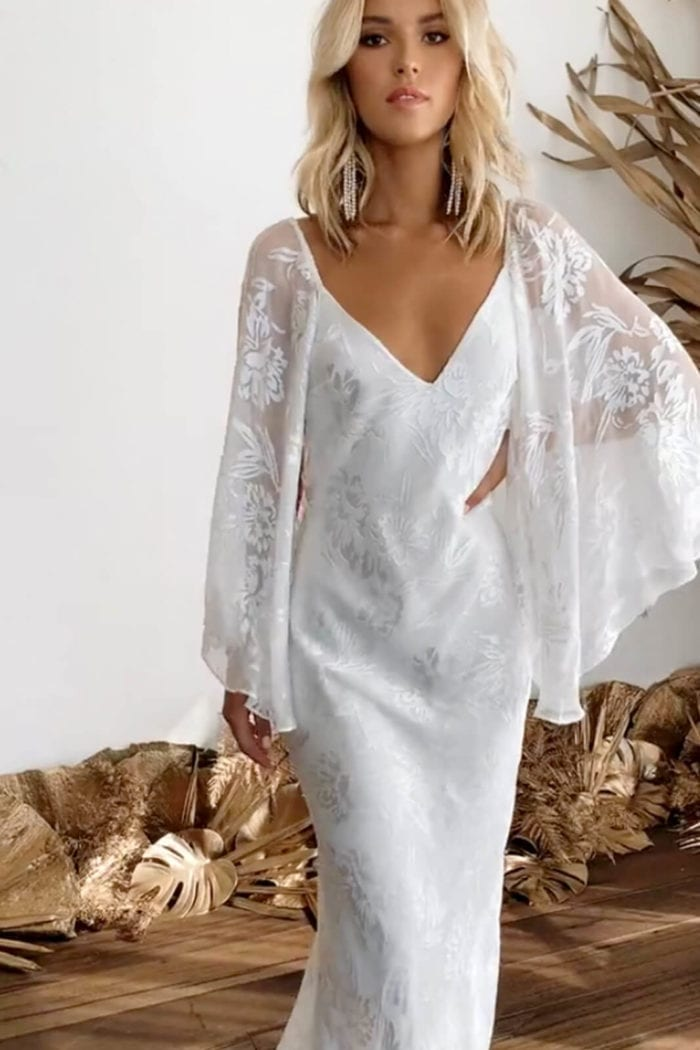 Blonde bride wearing Grace Loves Lace Loyola Gown With Sleeves with hand on hip