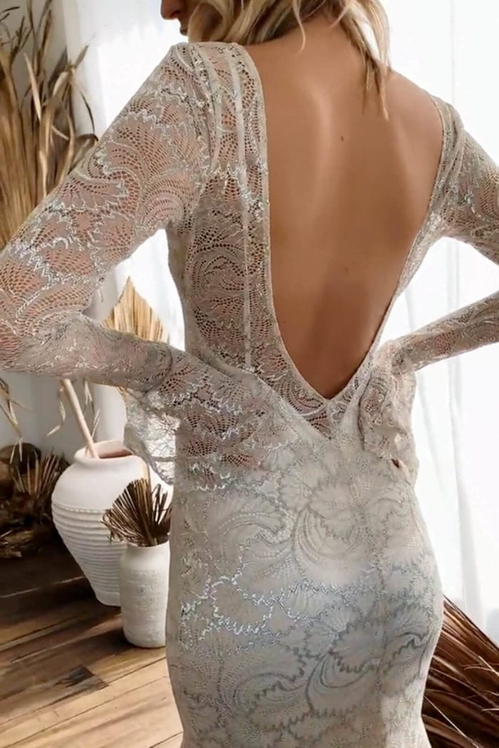 Back shot of bride wearing Grace Loves Lace Farrow Gown with hands on hips