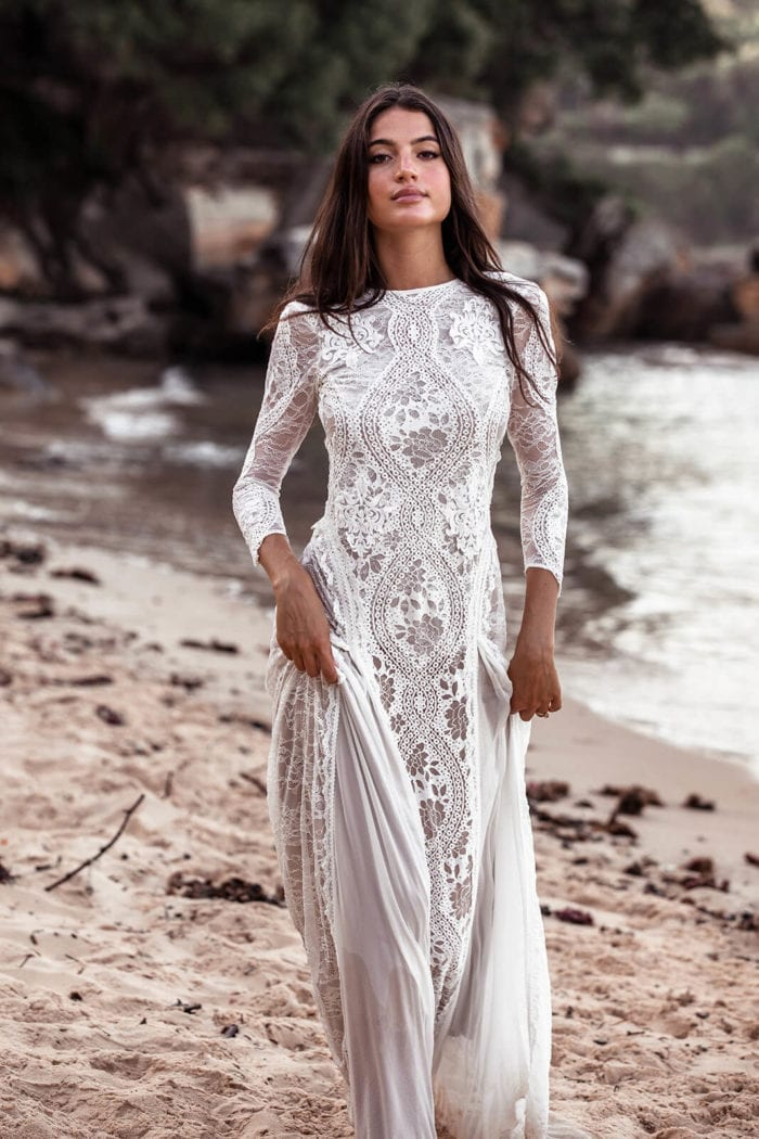 Bride wearing Grace Loves Lace Inca Gown on beach