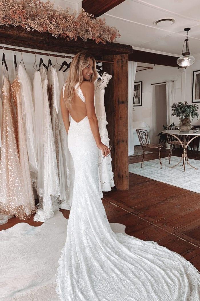 Back shot of bride wearing Grace Loves Lace Alexandra Rose Gown looking over shoulder