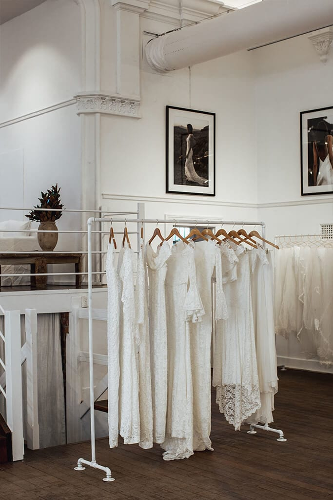 Ready made bridal gowns hanging on a rack in our Perth Bridal Gown Showroom