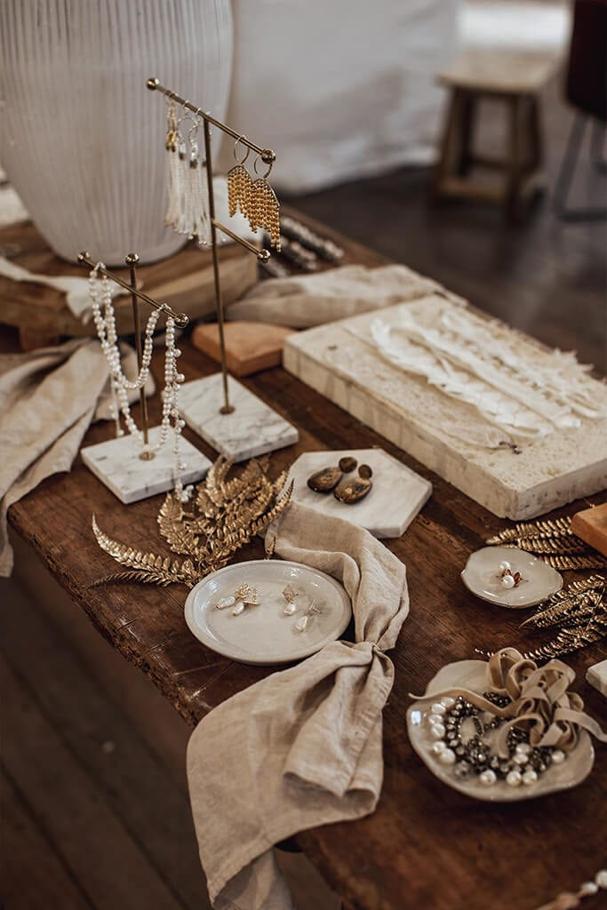 Accessories display on wooden table in our Perth Bridal Gown Showroom