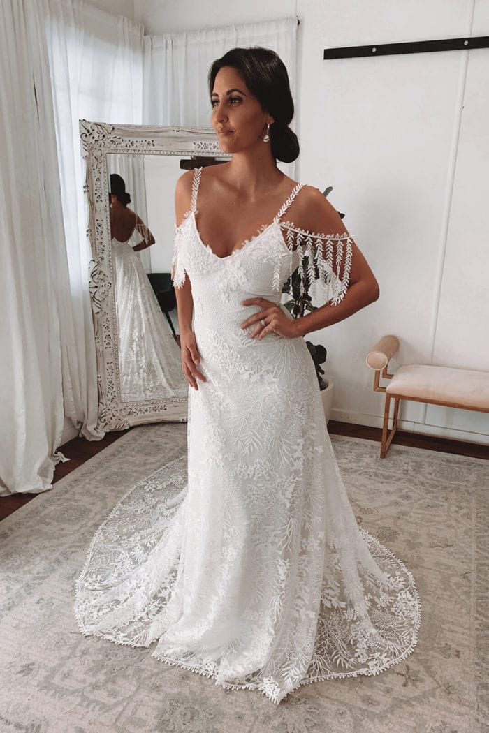 Bride wearing Grace Loves Lace Sol Gown with hand on hip