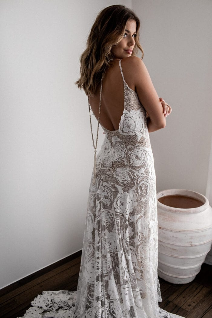 Back shot of bride wearing Grace Loves Lace Rosa Gown looking over shoulder