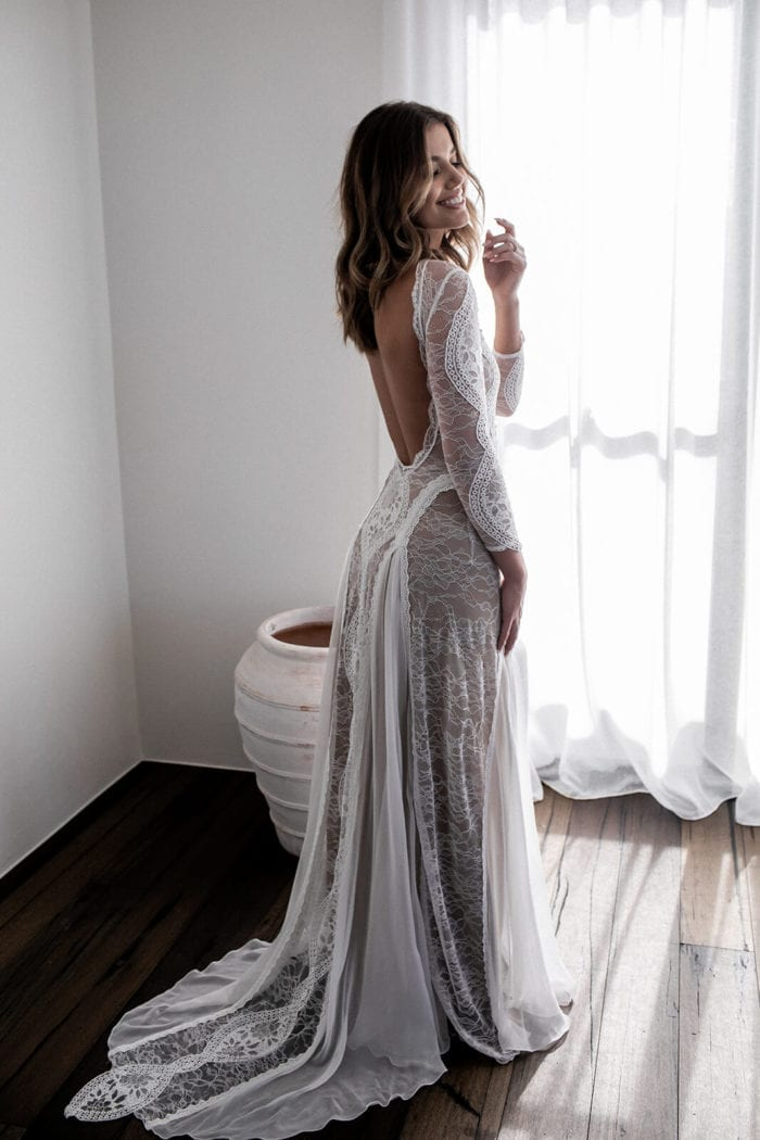 Back shot of bride wearing Grace Loves Lace Inca Gown looking over shoulder
