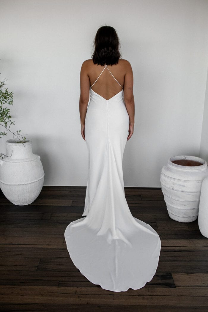 Back shot of brunette bride wearing Grace Loves Lace Dove Gown