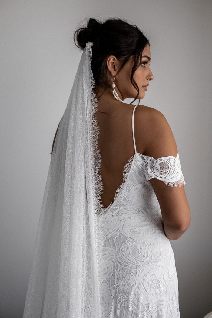 Back shot of bride wearing Grace Loves Lace Bonita Gown looking to the side