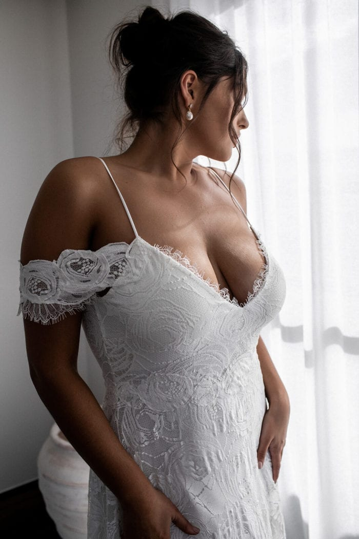 Bride wearing Grace Loves Lace Bonita Gown with hands on hips